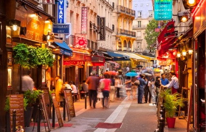 Shops and tourists along Rue Saint-Severin in the Latin Quarter, Paris France